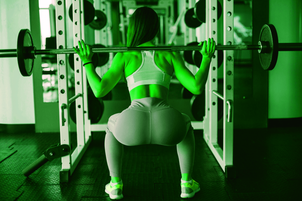 Woman squatting in Affordable Power Rack - heydayDo image