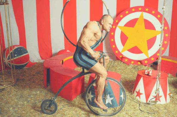 circus muscle man on his exercise bike - heydayDo image