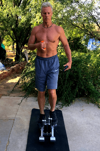 heydayDo author Greg Simon performing high intensity training on A Xiser Mini Stairmaster