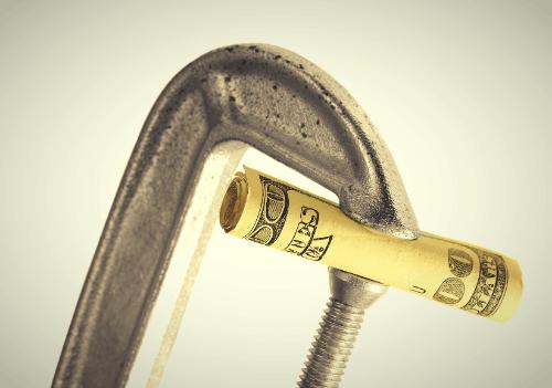 $100 bill in vice grip