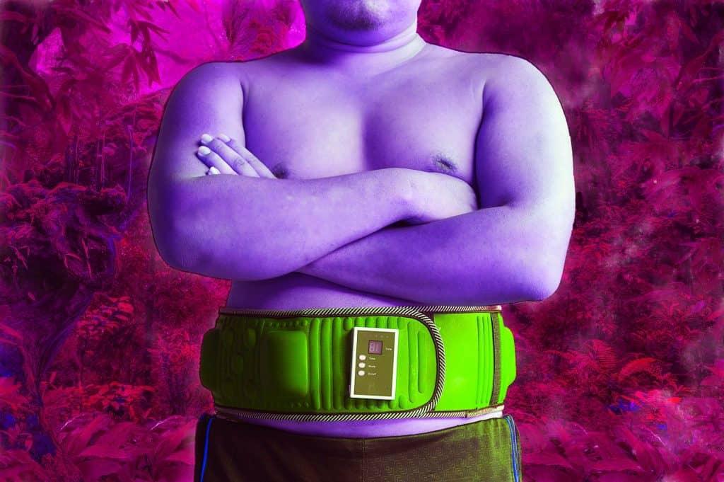 Overweight man wearing ab stimulator belt - heydayDo image
