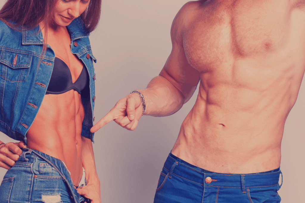 fit man & woman comparing each other's six-pack abs