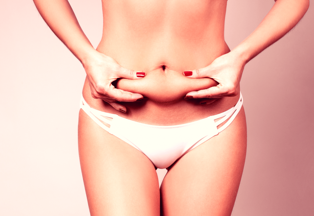 Skinny fat woman in white underwear pinching her belly fat with both hands, her fingernails have red polish on them