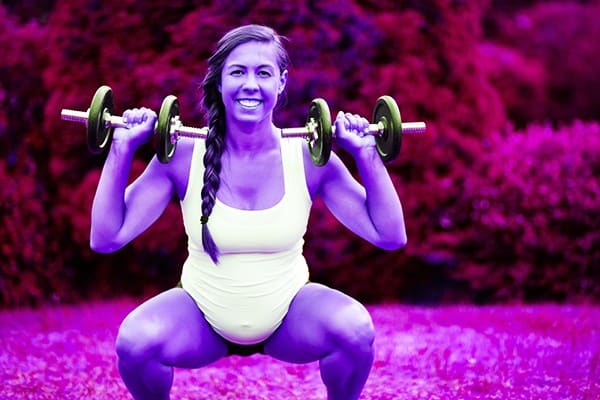 Pregnant Woman doing dumbbell front squats - heydayDo image