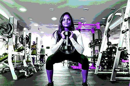 female doing a goblet squat - heydayDo image