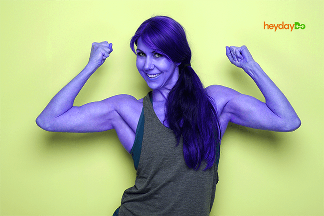50 year old woman with well-toned arm muscles - heydayDo image