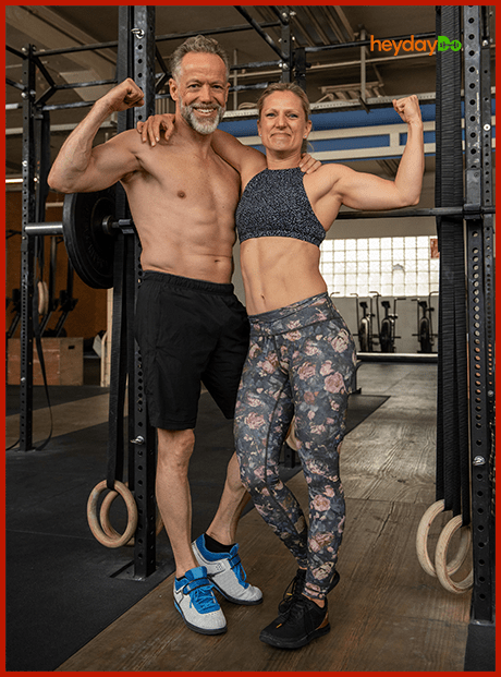 Fit older couple during strength training workout flexing toned arm muscles - heydayDo image